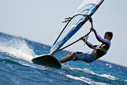 Side view of young windsurfer close-up