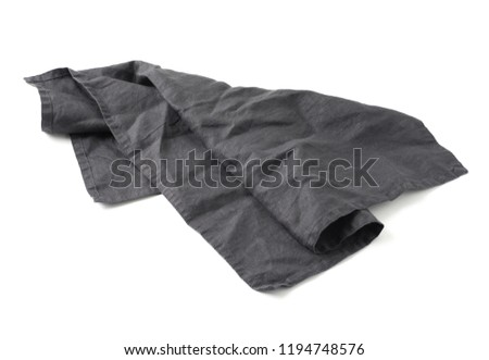 Side view on dark black linen napkin isolated on white background. Anthracite grey linen napkin. Isolated on white with clipping path.