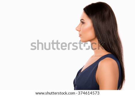 Side view photo of serious minded businesswoman in dark blue dress
