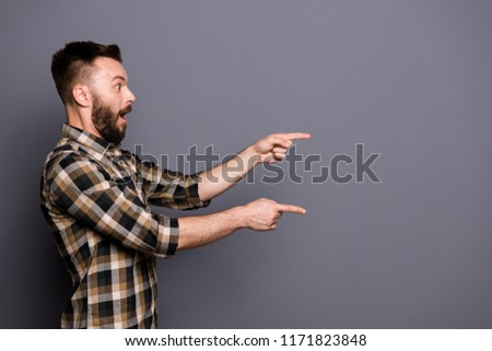 Side view photo of surprised handsome guy shows with his fingers on isolated gray background with copy space for text #1171823848