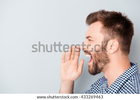 Side view photo of young man making important announcement