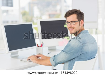 Side view portrait of a male artist using computer in the office