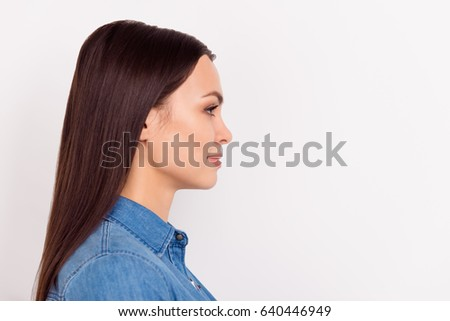 Side view portrait of beautiful smiling woman in casual clothes isolated on white background