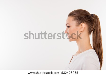 Side view portrait of beautiful woman with ponytail in white t-shirt isolated on white background