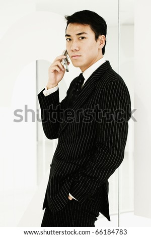 Side view portrait of businessman with cell phone