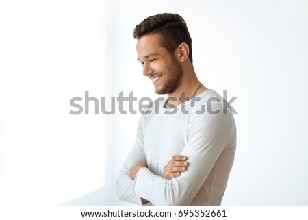 Side view portrait of smiling handsome man on white background with copy space
