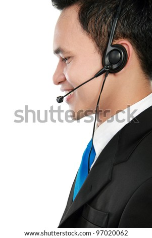 side view portrait of young call center operator speaking over headset
