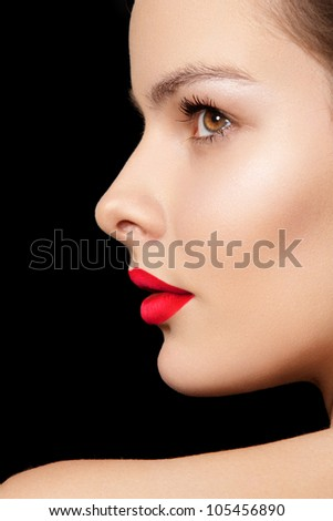 Side view portrait. Sexy woman model with bright red lips makeup, cheekbones and healthy shiny skin. Evening glamour style, fashion make-up