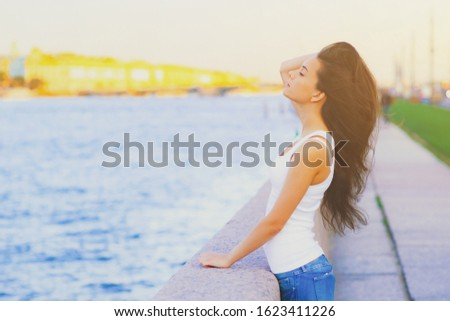 Side view profile portrait of a happy brunette woman relaxing breathing fresh air outdoors in summer Girl close eyes doing deep breath exercises. Positive emotion success, peace of mind, zen concept.