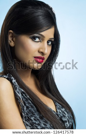Side view shot of a gorgeous lady wearing a beautiful dress and make up - stock photo