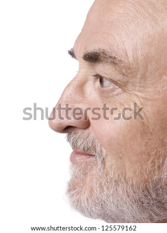 side view shot of an old man's face isolated in a white
