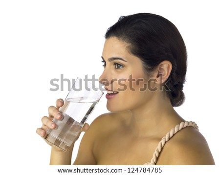 Side view shot of smiling woman about to drink a glass of water