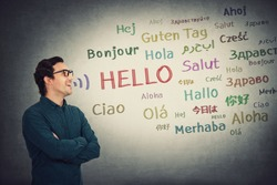 Side view skilled businessman talking different languages. Positive person, student or teacher, wearing glasses, open mouth speaking word hello in multiple languages. Learning and education concept.