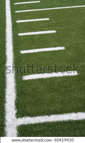 Sideline and yard markers on an American football field