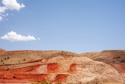 Sideling Hill, syncline, metamorphic layers, Allegheny Mountains, Appalachian Mountains for road construction in iran with blue cloudy sky