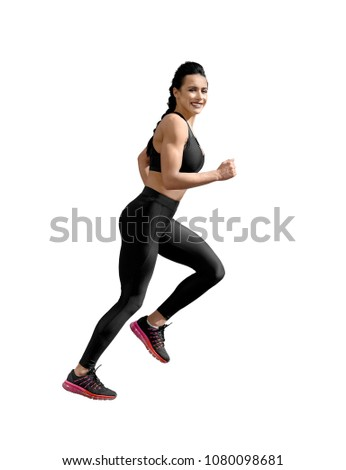 sideview of running athletic female. Smiling woman with fit, curvy body doing sport exercises. Model having slim, stunning figure, wearing sport trousers and top, also sneackers for professional run.