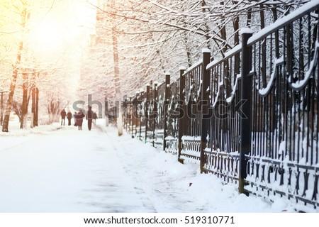 sidewalk along the fence