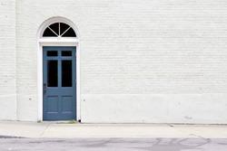 sidewalk by brick wall & door