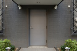 sidewalk by street wall & door