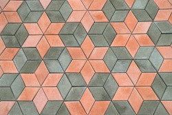Sidewalk, footpath, path made of beautiful modern paving slabs, geometric patterns. Abstract Gray orange background, texture of cement stone slabs. Close-up of material for floor, streets, house