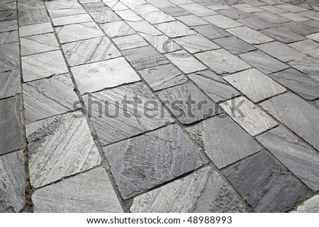 Sidewalk from stone tiles, grey color, horizontal