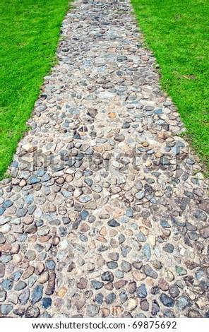 Sidewalk passage in green grass