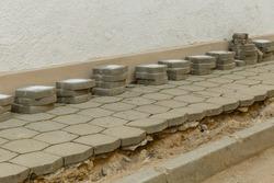 sidewalk repair. Replacing tiles on the sidewalk. replacement of paving slabs