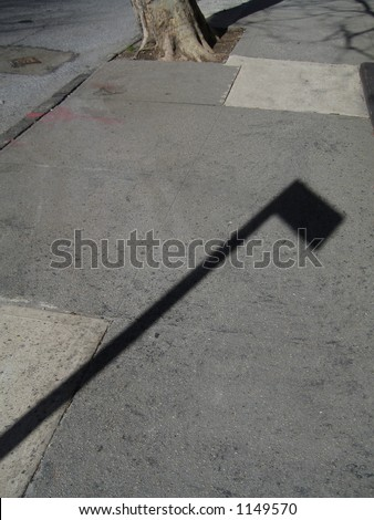sidewalk with shadow of sign