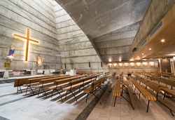 Sideways view of seating area and altar Built in 1969,during the socialist era in the brutalist style,it is Podgorica's only Catholic church.