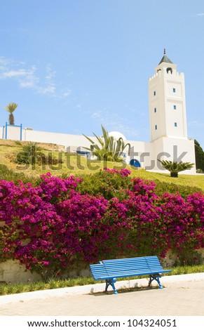 Sidi Bou Said Tunisia Africa  El Ghofrane  Tunisian mosque on Place du 7 Novembre   with flower garden