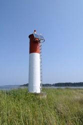 Sidney Spit lighthouse at the end of the spit, Gulf Islands National Park Reserve of Canada