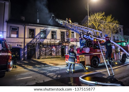 SIEDLCE, POLAND 29 April: Firefighters putting out a fire in the street at night on April 29 2013 in Siedlce, Poland
