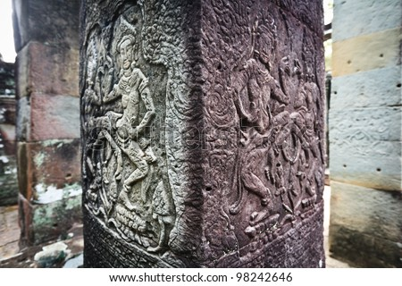SIEM REAP, CAMBODIA: Ancient carvings of apsara dancing woman take on different colors as the ruins of Angkor Wat age.