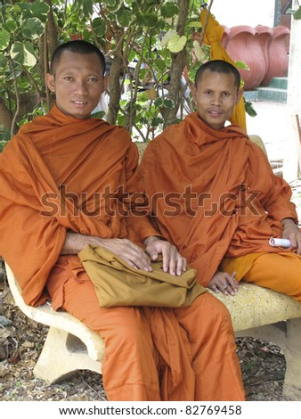 SIEM REAP, CAMBODIA- APRIL 1: Two unidentified Buddhist monks sitting in Siem Reap on April 1, 2011. Buddhism is currently estimated to be the faith of 96% of the Cambodian population.