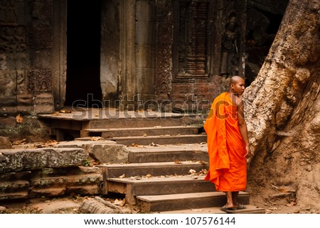 SIEM REAP, CAMBODIA - DECEMBER 26: Unidentified monk enters an ancient temple at the most visited historic UNESCO World Heritage site, Angkor Wat,Siem Reap on December 26, 2008, in Cambodia.