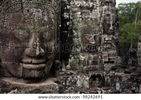 SIEM REAP, CAMBODIA: Face detail of Prasat Bayon temple complex statues.