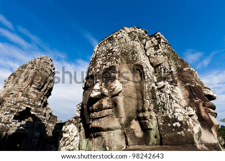 SIEM REAP, CAMBODIA: Famous head statues of ancient Prasat Bayon temple at Angkor Wat.