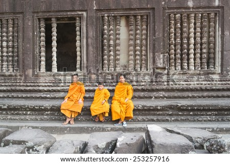 SIEM REAP, CAMBODIA -JAN 31 : Angkor Wat young buddhist monk. Famous landmark, place of worship and popular tourist travel destination in Asia. On January 1, 2015 in Siem Reap,Cambodia.