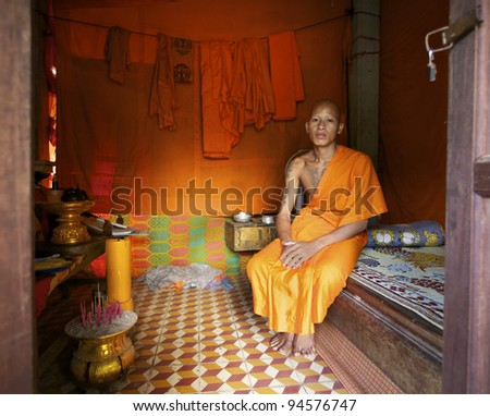 SIEM REAP, CAMBODIA-JAN 22:Unidentified Buddhist monk sitting in his room at Wat Atwea in Siem Reap on Jan. 22, 2012. Buddhism is currently estimated to be the faith of 96% of the Cambodian population
