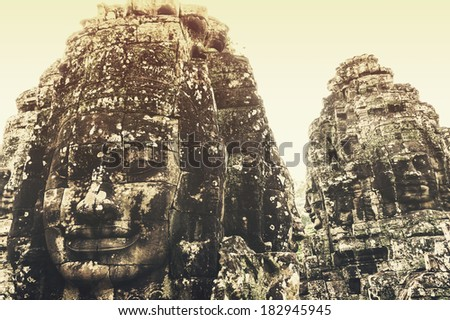 Siem Reap, Cambodia - October 23, 2013: Faces of Bayon in the summer time was the most popular among tourists to see.