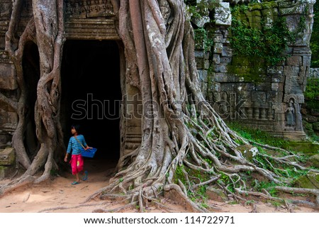 SIEM REAP, CAMBODIA - SEP 8:A girl at the Ta Som on Sep 8, 2012 in Angkor. Angkor was inscribed on the UNESCO World Heritage List in 1992. is one of the four major miracle in Oriental.