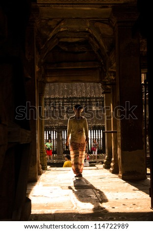 SIEM REAP, CAMBODIA - SEP 8:Visitor at the Angkor wat on Sep 8, 2012 in Angkor. Angkor was inscribed on the UNESCO World Heritage List in 1992. is one of the four major miracle in Oriental.