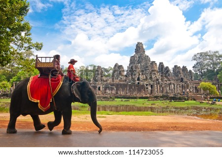 SIEM REAP, CAMBODIA - SEP 9:Visitor at the bayon on Sep 9, 2012 in Angkor. Angkor was inscribed on the UNESCO World Heritage List in 1992. is one of the four major miracle in Oriental.