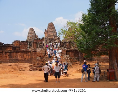 SIEM REAP - MARCH 21: Many tourist visited East Mebon in Siem Reap, Cambodia on March 21, 2012.East Mebon is a 10th Century temple dedicated to the Hindu god Shiva and honors the parents of the king.