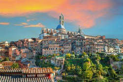 Siena - amazing medieval town at sunset with view of the Dome & Bell Tower of Siena Cathedral (Duomo di Siena), landmark Mangia Tower and Basilica of San Domenico,Italy