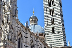 Siena Cathedral, which dedicated to the Assumption of Mary, is a medieval church in Siena. The facade of Siena Cathedral is one of the most fascinating in all of Italy.