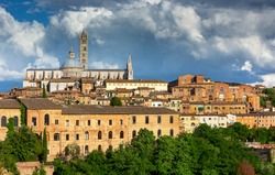 Siena historical medieval town with view of the Dome and Bell Tower of Siena Cathedral Duomo di Siena, Mangia Tower and Basilica of San Domenico, Italy