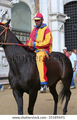 SIENA, ITALY - July 2: Chioccola Jockey exits the Palazzo Publico in preparation for the start of the palio, which takes place twice a year on July 2 and August 16, 2009 in Siena, Italy