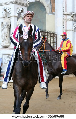 SIENA, ITALY - July 2: Istriche Jockey exits the Palazzo Publico in preparation for the start of the palio, which takes place twice a year on July 2 and August 16, 2009 in Siena, Italy