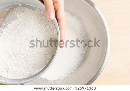 Sifting flour into the bowl,food ingredient,prepare for cooking or baking #325971368